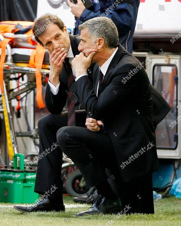 AC Milan coach Massimiliano Allegri, right, talks with his vice Mauro Tassotti during the Serie A soccer match between AC Milan and Fiorentina at the San Siro stadium in Milan, Italy. AC Milan announced on its website that it fired coach Massimiliano Allegri and put assistant Mauro Tassotti temporarily in charge following AS Milan's embarassing 4-3 loss to Sassuolo on Sunday, Jan.12