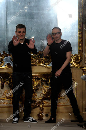 Italian stylists Tommaso Aquilano and Roberto Rimondi acknowledge the applause at the end of their Aquilano.Riimondi women's Fall-Winter 2012-13 fashion collection, presented in Milan, Italy