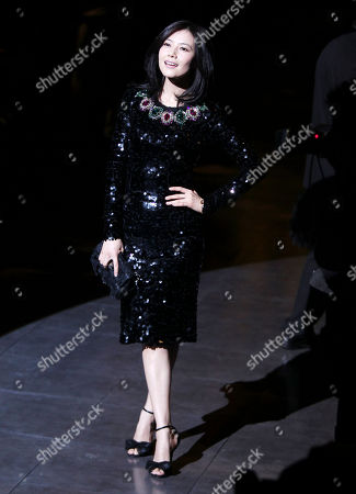 Chinese actress Gao Yuanyuan poses prior to the start of the Dolce & Gabbana women's Fall-Winter 2012-13 fashion collection show, during the fashion week in Milan, Italy