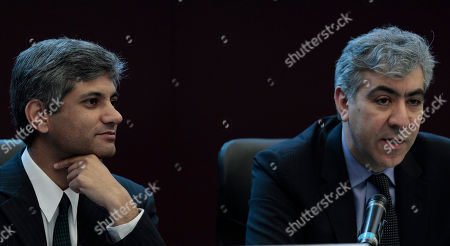 Aasim Husain, Reza Moghadam Vice Director of the IMF's European Department, Aasim Husain, left, and Director of the IMF's European Department, Reza Moghadam, attend a press conference at the end of a meeting with Italian Premier Mario Monti, in Rome