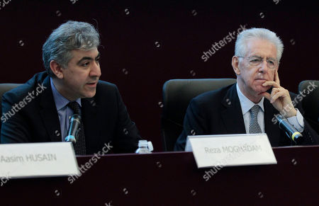 "Italian Premier Mario Monti, right, and Director of the IMF's European Department, Reza Moghadam talk to the press at the end of their meeting in Rome, . Moghadam praised Italy's reform course. Premier Mario Monti said the IMF's mission shows how much Italy ""has done and needed to do to put its public accounts on a safe basis and launch incisive reforms"