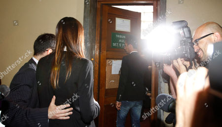 """Italian People for Freedom party local politician and former showgirl Nicole Minetti, arrives at a court room during a break of a trial in Milan's court, Italy, . Minetti, along with other two ex-Italian Premier Silvio Berlusconi aides, Emilio Fede, an executive in Berlusconi's media empire, and talent agent Dario """"Lele"""" Mora, has gone on trial on charges for allegedly recruiting an underage Moroccan girl and other women for prostitution at Berlusconi's villas. Berlusconi is being tried separately for allegedly paying for sex with the Moroccan girl, charges he denies"""