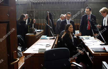 """Italian People for Freedom party local politician and former showgirl Nicole Minetti, center, looks on during a break of a trial in Milan's court, Italy, . Minetti, along with other two ex-Italian Premier Silvio Berlusconi aides, Emilio Fede, an executive in Berlusconi's media empire, and talent agent Dario """"Lele"""" Mora, has gone on trial on charges for allegedly recruiting an underage Moroccan girl and other women for prostitution at Berlusconi's villas. Berlusconi is being tried separately for allegedly paying for sex with the Moroccan girl, charges he denies"""