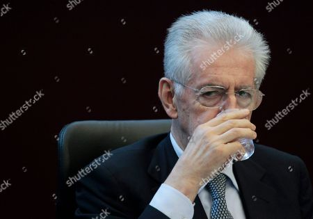 Italian Premier Mario Monti takes a drink during a press conference after a meeting with the Director of the IMF's European Department, Reza Moghadam in Rome, . Mario Monti, hailed as a savior in November when he was named premier to tackle Italy's financial crisis, is feeling the sting himself as he comes under attack from all sides _ variously described as a cold-hearted economist, a slave to the banks or a softie lacking the courage to push harder with reforms