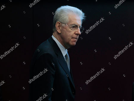 Italian Premier Mario Monti arrives for a press conference after a meeting with the Director of the IMF's European Department, Reza Moghadam in Rome, . Mario Monti, hailed as a savior in November when he was named premier to tackle Italy's financial crisis, is feeling the sting himself as he comes under attack from all sides _ variously described as a cold-hearted economist, a slave to the banks or a softie lacking the courage to push harder with reforms