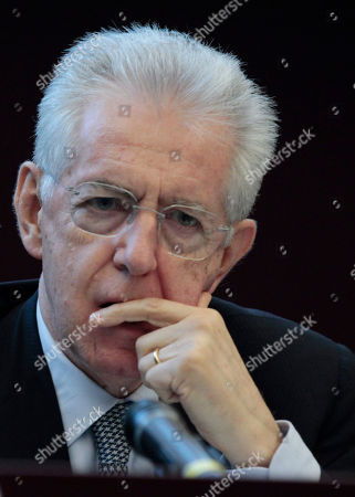 Stock Picture of Italian Premier Mario Monti arrives at a press conference at the end of a meeting with Director of the IMF's European Department, Reza Moghadam in Rome, . Mario Monti, hailed as a savior in November when he was named premier to tackle Italy's financial crisis, is feeling the sting himself as he comes under attack from all sides - variously described as a cold-hearted economist, a slave to the banks or a softie lacking the courage to push harder with reforms