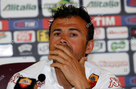 Louis Enrique Roma coach Luis Enrique ponders a question during a news conference in Rome, . The Spanish coach informed of his decision to quit and said he will take a year off from football after his last game with the Serie A club Sunday