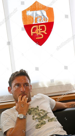 Stock Image of Louis Enrique AS Roma player Francesco Totti attends coach Luis Enrique's news conference in Rome, . The Spanish coach informed of his decision to quit and said he will take a year off from football after his last game with the Serie A club Sunday
