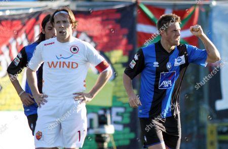 German Denis, Rodrigo Taddei Atalanta's German Denis, right, of Argentina, reacts after scoring as AS Roma's Rodrigo Taddei looks on during a Serie A soccer match in Bergamo, Italy