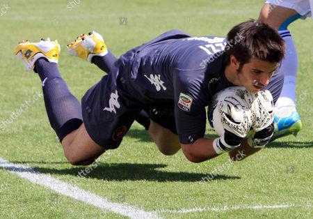 Cagliari's Michael Agazzi saves the ball during a Serie A soccer match between Cagliari and Atalanta in Cagliari, Italy