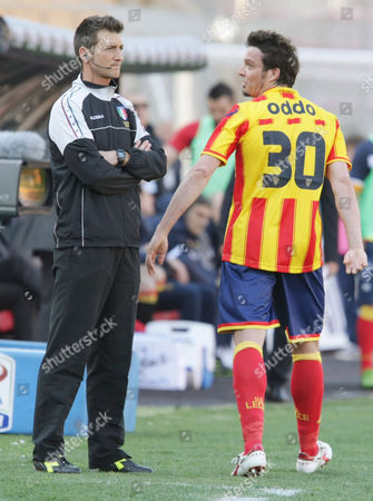Massimo Oddo Lecce's Massimo Oddo, right, leaves the pitch after receiving the red card during a Serie A soccer match between Lecce and Palermo, at the Via del Mare stadium in Lecce, Italy