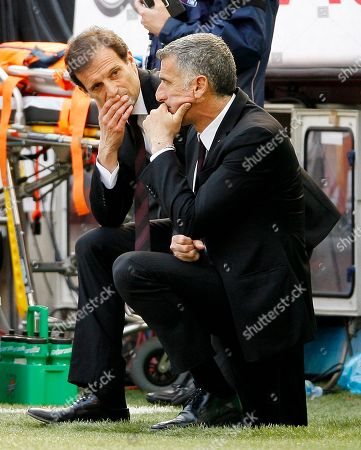 AC Milan coach Massimiliano Allegri, right, talks with his vice Mauro Tassotti during the Serie A soccer match between AC Milan and Fiorentina at the San Siro stadium in Milan, Italy