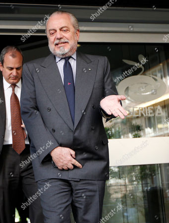 Napoli president Aurelio De Laurentis leaves the 'Lega calcio' headquarter after a meeting, in Milan, Italy, . Juventus completed the recovery from its darkest period following the 2006 matchfixing scandal as it claimed its first Serie A title in nine years Sunday