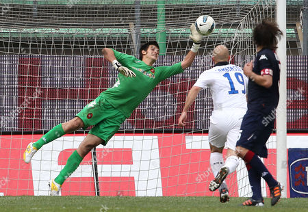 Cagliari's Goalkeeper Michael Agazzi, left, saves on Inter's Esteban Cambiasso, of Argentina, during the Serie A soccer match between Cagliari and Inter Milan, at the Nereo Rocco stadium in Trieste, Italy