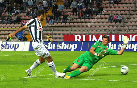 Juventus's Mirko Vucinic, of Montenegro, left, scores past Cagliari goalkeeper Michael Agazzi during the Serie A soccer match between Cagliari and Juventus, at the Nereo Rocco Stadium in Trieste, Italy