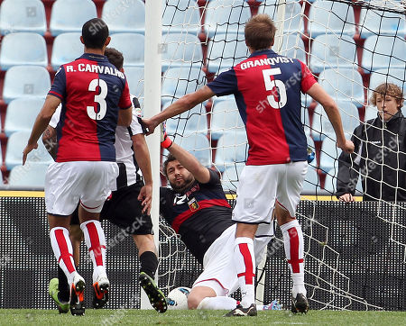 Udinese's Antonio Di Natale, scores past Genoa goalkeeper Sebastien Frey during the Serie A soccer match between Udinese and Genoa, at the Friuli Stadium in Udine, Italy