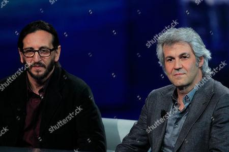 """Italian film maker Daniele Vicari, left, and movie producer Domenico Procacci attend the Italian State RAI TV program """"Che Tempo che Fa"""", in Milan, Italy"""