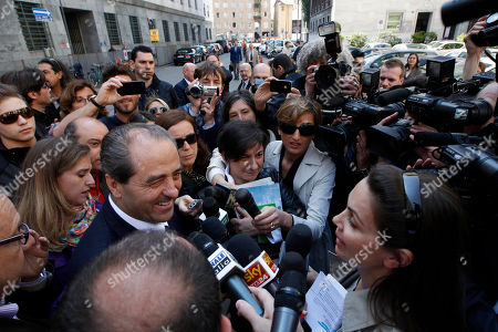Former PM and Italia dei Valori leader Antonio Di Pietro meets the press outside the tribunal after giving his testimony in a process where Silvio and his brother Paolo Berlusconi are accused, in Milan, Italy