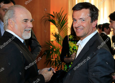Italian journalist and entrepeneur Giorgio Gori, right, is flanked by Italian TV director Antonio Ricci attend the journalism prize event 'E' Giornalismo' in Milan, Italy, Thursday, March, 22, 2012