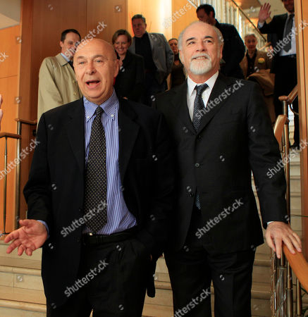 Italian journalist Paolo Mieli and Italian TV director Antonio Ricci attend the journalism prize event 'E' Giornalismo' in Milan, Italy, Thursday, March, 22, 2012