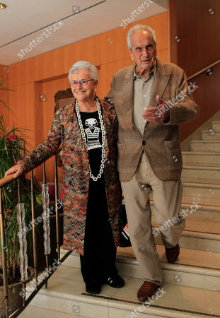 Italian fashion designer Ottavio Missoni is flaked by his wife Rosita Jelimini attend the journalism prize event 'E' Giornalismo' in Milan, Italy, Thursday, March, 22, 2012
