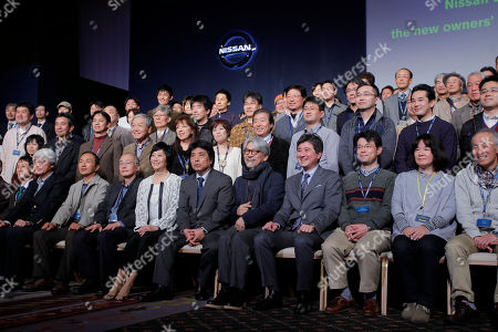 Ryuichi Sakamoto, Hideaki Watanabe Japanese composer Ryuichi Sakamoto, seated at fifth right, Nissan Motor Co's Corporate Vice President Hideaki Watanabe, seated at fourth right, and Japanese novelist Ryu Murakami, seated at sixth right, pose with other owners of Nissan Leaf zero-emission electric vehicles, during the automaker's 'The New Owner's Meeting' in Tokyo. The electric car owners who prided themselves on being green now find themselves in a bind as Japan's government maneuvers to restart dozens of nuclear power plants idled after last year's meltdowns