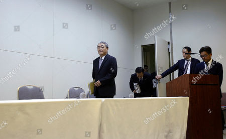 Toshio Nishizawa Tokyo Electric Power Co. President Toshio Nishizawa, center, arrives for a news conference at the company's head office in Tokyo after a public bailout was approved, . The government approved a 1 trillion yen ($12.5 billion) public bailout for the operator of Japan's tsunami-devastated Fukushima Dai-ichi nuclear power plant and put it under temporary state control