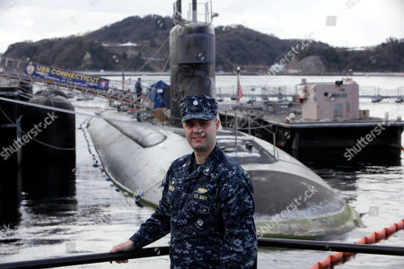Commander Ian Johnson stands in front of the USS Connecticut, a Sea Wolf-class nuclear submarine, during a port call at a U.S. naval base at Yokosuka, south of Tokyo, Japan. The submarine took part in exercises at the North Pole in 2011 to improve the U.S. Navy's operations in the Arctic. To the world's military leaders, the debate over climate change is long over. They are preparing for a new kind of Cold War in the Arctic, anticipating that rising temperatures there will open up a treasure trove of resources, long-dreamed-of sea lanes and a slew of potential conflicts