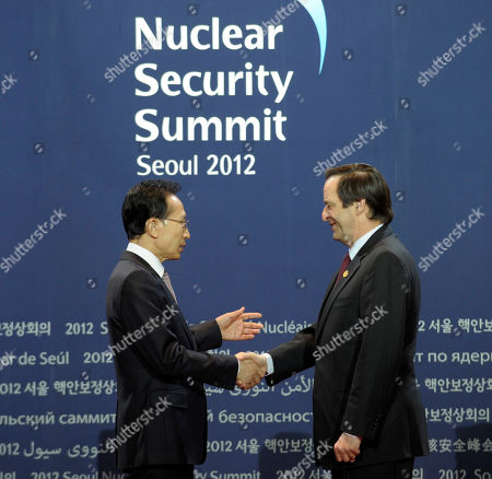 Stock Picture of Lee Myung-bak, Dan Meridor South Korean President Lee Myung-bak greets Israeli Minister of Intelligence and Atomic Energy Dan Meridor during a welcome ceremony for the Nuclear Security Summit at the Coex Center, in Seoul, South Korea