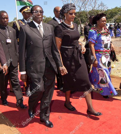 Stock Photo of Robert Mugabe, Grace Mugabe Zimbabean president Robert Mugabe, left and his wife Grace, right, attend the state funeral of the late president Bingu wa Mutharika in Blantyre, Malawi, . Mutharika died April 5 after suffering a heart attack. He was 78 years old