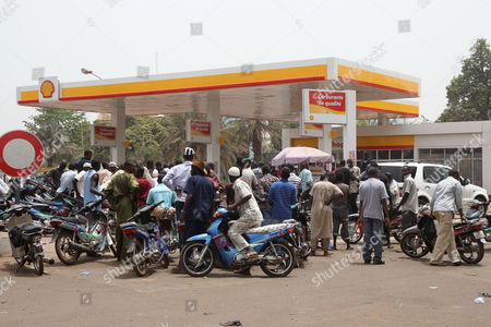 Moped drivers seeking petrol crowd a gas station, during fuel shortages following a military coup, in Bamako, Mali . Mali's U.S.-trained coup leader Amadou Sanogo said Saturday that he had no fears of a countercoup and no soldiers were protecting the ousted president Amadou Toumani Toure