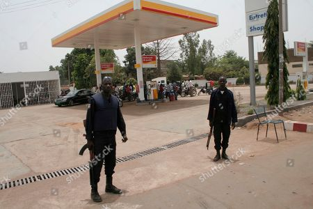 Police stand guard as drivers wait for petrol at a gas station, during fuel shortages following a military coup, in Bamako, Mali . Mali's U.S.-trained coup leader Amadou Sanogo said Saturday that he had no fears of a countercoup and no soldiers were protecting the ousted president Amadou Toumani Toure