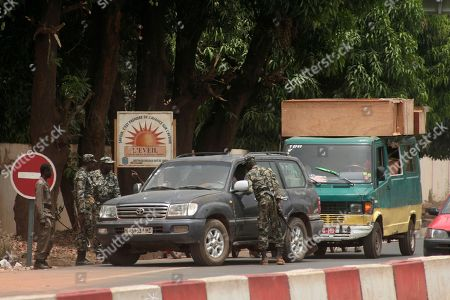 Soldiers confiscate a van, right, carrying what they say were looted goods, days after a military coup, in Bamako, Mali . The van was taken to a military base, where soldiers said they would hold the stolen items until the owner could be identified. Mali's U.S.-trained coup leader Amadou Sanogo said Saturday that he had no fears of a counter coup and no soldiers were protecting the ousted president Amadou Toumani Toure