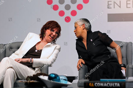 """Cecilia Rosseto, Eugenia Leon Singers Cecilia Rosseto, from Argentina, left, and Eugenia Leon, from Mexico, speak during a conference at the Second International Congress """"The Intellectual experience of Women in the XXI Century"""" in Mexico City"""