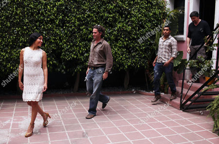 "Actors Dolores Heredia from Mexico, left, Tenoch Huerta from Mexico, second from right, Carlos Bardem from Spain, far right, and Mexico's film Director Everardo Gout, second from left, walk prior to a photo session during an interview about their movie ""Dias de Gracia,"" or ""Days of Grace"" in Mexico City, . The movie premieres on April 13 in Mexico City"