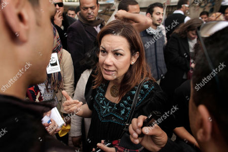 "Bothaina Kamel Egyptian presidential hopeful Bothaina Kamel speaks to reporters at a demonstration against a court ruling that cleared a military doctor of charges he forced a ""virginity test"" on female activists, in front of the high court in Cairo, Egypt, . Protesters on Friday carried posters of Samira Ibrahim, the young female activist who filed a lawsuit against a military doctor accusing him of subjecting her to a ""virginity test"" last year after she was detained by the army during a protest"