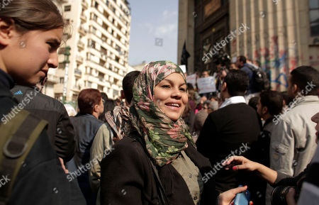"Samira Ibrahim Activist Samira Ibrahim attends a demonstration against a court ruling that cleared a military doctor of charges he forced a ""virginity test"" on female activists, in front of the high court in Cairo, Egypt, . Protesters on Friday carried posters of Samira Ibrahim, the young female activist who filed a lawsuit against a military doctor accusing him of subjecting her to a ""virginity test"" last year after she was detained by the army during a protest"