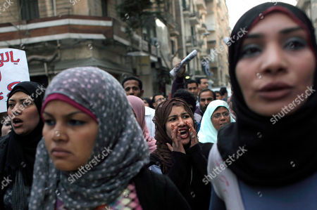 Egyptian activist Samira Ibrahim, second left attends a rally while fellow activists chant anti Military Supreme Council slogans during a protest in Tahrir square, Cairo, Egypt . Egyptian activists protested a military tribunal verdict acquitting an army doctor of an accusation of public obscenity filed by a protester who claimed she was forced to undergo a virginity test while in detention among seven women detained by the military a year ago