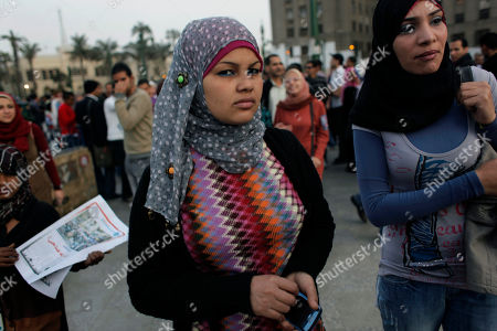 "Samira Ibrahim Egyptian activist Samira Ibrahim, center, attends an anti Military Supreme Council protest in Tahrir square, Cairo, Egypt. Women protesters and rights groups have accused Egyptian military and prison authorities of sexual assault and abuse on female detainees in the latest crackdown on demonstrations. There was outrage last year against ""virginity tests"" performed by a military doctor on female detainees last year"