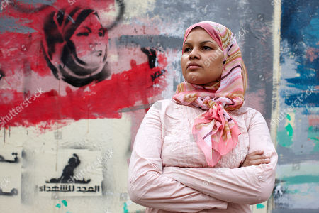 "Samira Ibrahim Egyptian activist Samira Ibrahim stands next to a mural depicting her in Cairo, Egypt. Samira Ibrahim was forced to undergo a ""virginity test"" while in detention by the military after protests in Cairo. She later filed a lawsuit against a military doctor"