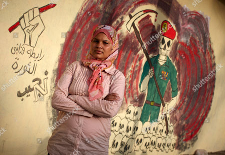 "Samira Ibrahim Egyptian activist Samira Ibrahim stands next to a mural In Cairo, Egypt. Samira Ibrahim was forced to undergo a ""virginity test"" while in detention by the military after protests in Cairo. She later filed a lawsuit against a military doctor"