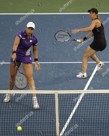 Liezel Huber, of South Africa left, and Lisa Raymond of the United States in action during doubles final against Sania Mirza from India and Elena Vesnina from Russia during at Dubai Duty Free Tennis Championships, in Dubai, United Arab Emirates