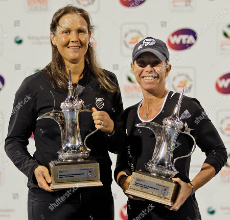 Stock Picture of Liezel Huber, Lisa Raymond Liezel Huber, left, and Lisa Raymond of the United States hold their trophies after defeating Sania Mirza from India and Elena Vesnina from Russia in the women's doubles final at Dubai Duty Free Tennis Championships, in Dubai, United Arab Emirates