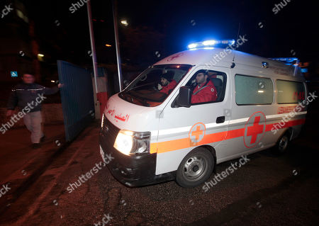 A Lebanese Red Cross ambulance follows Lebanese police vehicles carrying two injured French journalists who were trapped at Baba Amr neighborhood in Homs province after they were wounded by the Syrian government forces shelling, to enter the hospital of Hotel Dieu, in Beirut, Lebanon, on early . Two French journalists, Edith Bouvier and William Daniels, have escaped to Lebanon after being trapped in Baba Amr, French President Nicolas Sarkozy said late Thursday. Bouvier was wounded last week in a government rocket attack on a makeshift media center that killed American-born journalist Marie Colvin and French photographer Remi Ochlik. Bouvier is asking for a European ambassador to accompany any evacuation, said Burhan Ghalioun, head of the opposition Syrian National Council, at a Paris news conference