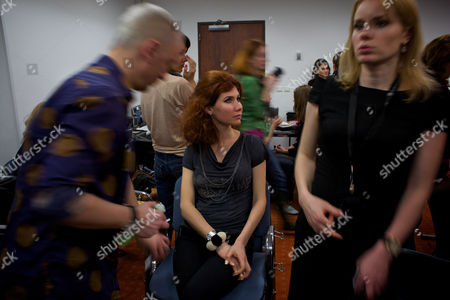 Anna Chapman Russian Anna Chapman, center, who was deported from the U.S. on charges of espionage, looks on as she prepares to display a creations by I Love Fashion, France, during Fall-Winter 2012 - 2013 collection at Mercedes-Benz Fashion Week in Moscow, Russia