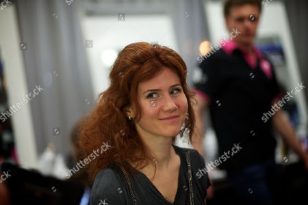 Anna Chapman Russian Anna Chapman, who was deported from the U.S. on charges of espionage, smiles as she prepares to display a creations by I Love Fashion, France, during Fall-Winter 2012 - 2013 collection at Mercedes-Benz Fashion Week in Moscow, Russia