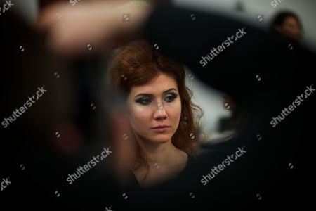 Anna Chapman Russian Anna Chapman, who was deported from the U.S. on charges of espionage, looks on as a photographer takes a photo of her at a beckstage as she prepares to display a creations by I Love Fashion, France, during Fall-Winter 2012 - 2013 collection at Mercedes-Benz Fashion Week in Moscow, Russia