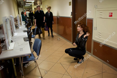 Anna Chapman Russian Anna Chapman, right, who was deported from the U.S. on charges of espionage, looks at a mirror at a backstage as she prepares to display a creations by I Love Fashion, France, during Fall-Winter 2012 - 2013 collection at Mercedes-Benz Fashion Week in Moscow, Russia