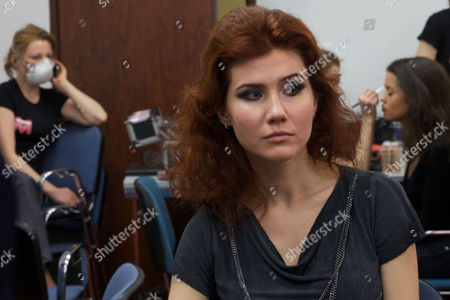 Anna Chapman Russian Anna Chapman, who was deported from the U.S. on charges of espionage, waits for a make-up as she prepares to display a creations by I Love Fashion, France, during Fall-Winter 2012 - 2013 collection at Mercedes-Benz Fashion Week in Moscow, Russia