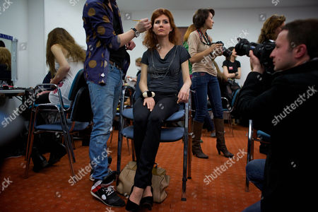 Anna Chapman A stylist, left, makes-up Anna Chapman, center, who was deported from the U.S. on charges of espionage, preparing to display a creations by I Love Fashion, France, during Fall-Winter 2012 - 2013 collection at Mercedes-Benz Fashion Week in Moscow, Russia